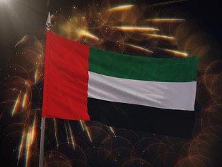 Flag of the United Arab Emirates with fireworks display in the background