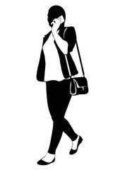Silhouette of a walking woman with phone
