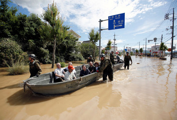 Japan Self-Defense Force soldiers rescue people from a flooded area in Mabi town in Kurashiki