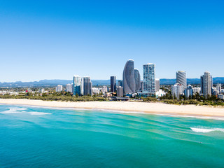 An aerial view for the Broadbeach skyline on the Gold Coast in Queensland with blue water