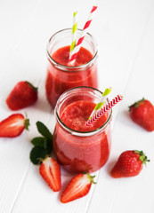Jars with strawberry smoothie