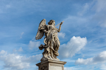 Statue with blue sky and fluffy cloud background
