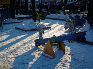 children's Playground in winter on a clear day