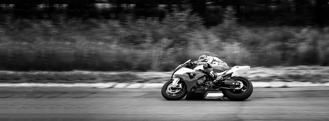 motorcycle racer on highway and ring races. black and white