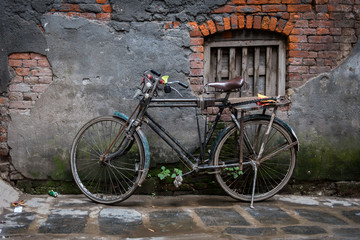 Old bicycle on its stand by a decaying old wall, Ason Tol, Kathmandu, Nepal