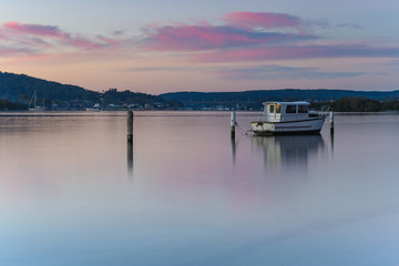 Pink Clouds and Boat on the Bay