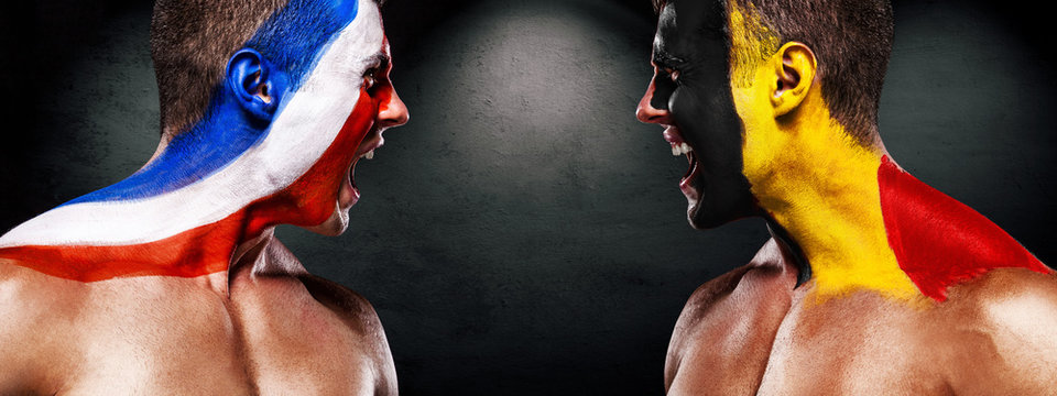 Soccer or football fan athlete with bodyart on face - flags of France vs Belgium. Sport Concept with copyspace.