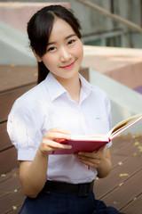 asia thai high school student uniform beautiful girl read a book
