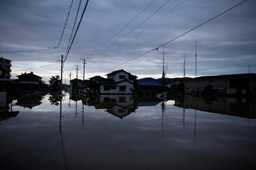 Submerged houses are seen in a flooded area in Mabi town in Kurashiki,