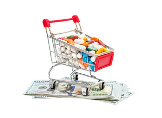 Poster Full shopping cart with pills on dollar bills on white background.