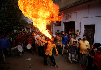 A Hindu devotee performs a stunt during rehearsals ahead of the annual Rath Yatra, or chariot procession, in Ahmedabad
