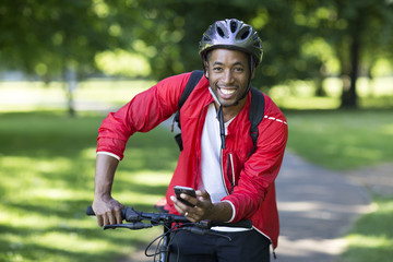 cyclist holding his phone
