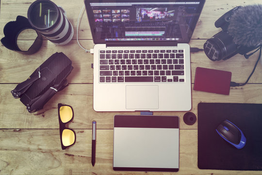 Top view the laptop Camera and drone gear for editor man or freelance Vlogger and lifestyle working in studio