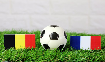 ball with Belgium VS France flag match on Green grass football 2018