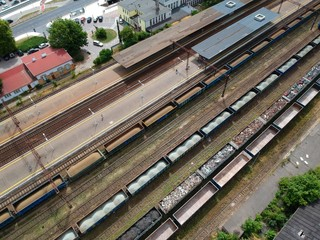 Aluminium Prints Train Station Cargo wagons on train station in city, aerial view
