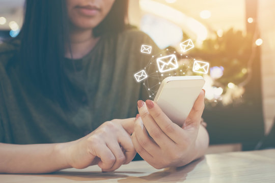 Happy woman hand using mobile phone with e-mail application, Concept email marketing and newsletter