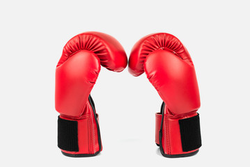Red leather boxing gloves isolated on white background Wall mural