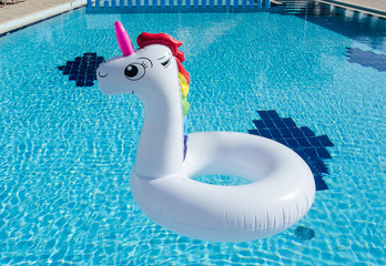 Unicorn inflatable float for kids and adult. Summer holidays, beach vacation. Fantasy swim ring. Copyplace, place for text