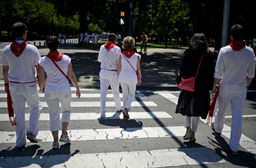 Couples hold hands on the third day of the San Fermin festival in Pamplona