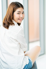 beautiful asian charming girl smile and peaceful happiness on sofa in living area house concept