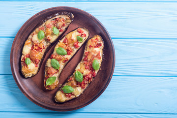 Eggplant with tomatoes , cheese and basil