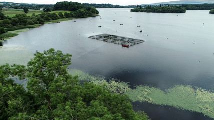 Aerial image over the fish farm and anglers in little boats on the Lake of Menteith.