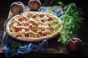 Closeup of fresh and homemade tart with peaches