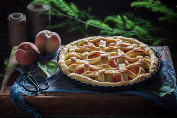 Homemade and rustic peach pie made of fresh fruits