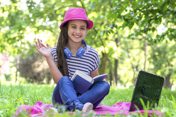 Lifestyle person Girl enjoy listening music and reading a book and play laptop