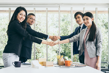 business successful ideas concept with handshake of two partner deal project with happiness and powerful energy