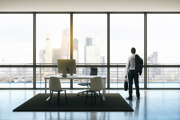 businessman in penthouse office