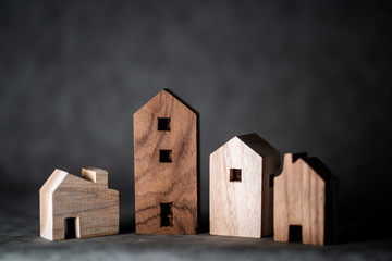 many toy wooden house block on grey leather background