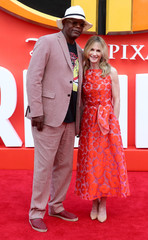 Actors Holly Hunter and Samuel L. Jackson pose for photographs as they arrives at the UK premiere of Incredibles 2 in London