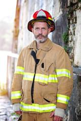 portrait of handsome fireman in uniform