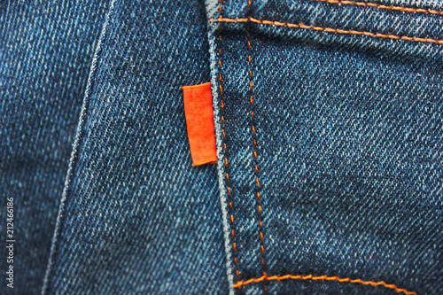 3631bed4c10 Denim Jeans Empty Red Label Close Up. Casual Vintage Style Jean Clothing  Back Side Tag View. Dark Blue Denim Jeans Material with Empty Brand Label