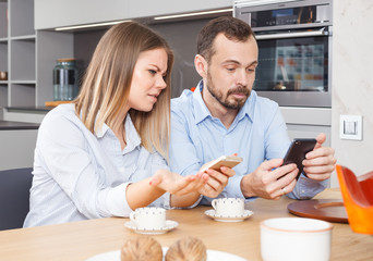 Irritated spouses with phones