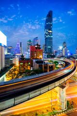 Wall Mural - Aerial view of Bangkok modern office buildings and condominium in Bangkok city downtown with blue sky and clouds at Bangkok, Thailand. BTS skytrain