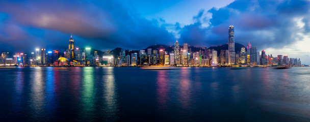 Fototapete - Panorama of Hong Kong City skyline at night. View from across Victoria Harbor Hongkong.
