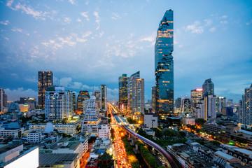 Wall Mural - Aerial view of Bangkok skyline and skyscraper with BTS skytrain Bangkok downtown. Panorama of Sathorn and Silom business district Bangkok Thailand at night.