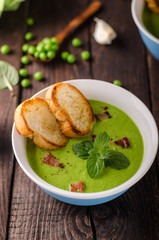 Pea soup, fresh herbs and bacon