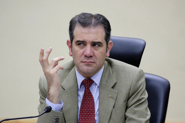President of the National Electoral Institute (INE), Lorenzo Cordova, gestures as he delivers the results for the new places at the Senate after the election in Mexico City