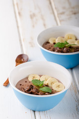 Chocolate pudding, banana and herbs in