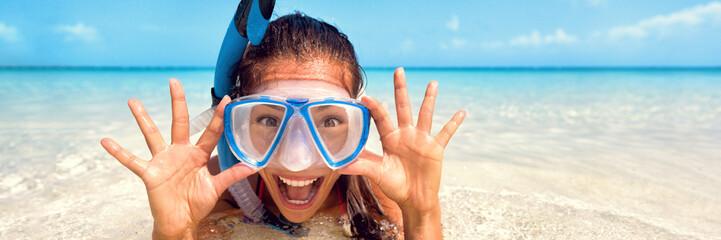 Snorkel watersport girl fun - Happy Asian tourist woman screaming of joy enjoying swimming with scuba mask on summer Caribbean travel vacation holidays banner panorama.