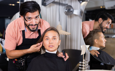 male hairdresser and female in beauty salon