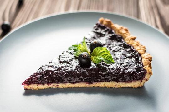 Homemade summer berry tart on a wooden background