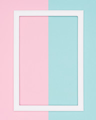 Abstract geometrical pastel blue and pink colored paper flat lay background. Minimalism template with empty picture frame mock up.