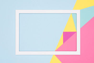 Abstract geometry flat lay pastel blue, pink and yellow paper texture minimalism background. Minimal geometric shapes and lines template with empty picture frame mock up.