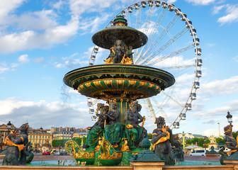Fountain and ferris wheel in Paris