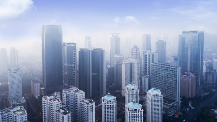 Office buildings with air pollution at morning time
