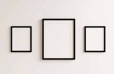 Blank black picture frame template for place image or text inside on white wall.